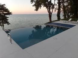 infinity edge fiberglass pool with automatic cover coastal swimming pool