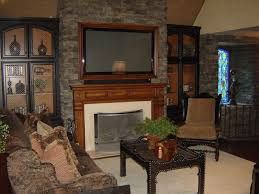 framed tv over fireplace entertainment center terranean family room