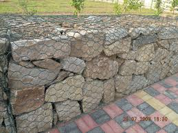 chic brick paver matched with Gabion Baskets retaining wall filled with  stones for landscaping ideas