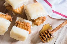 fil a en biscuit served at breakfast the bite sized breaded en nuggets are served on soft yeast rolls lightly coated with honey er