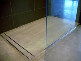 modern open concept bathroom featuring a concrete floor a curbless shower and a linear drain created by mode concrete