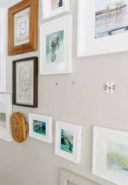 if you ve wanted a perfect gallery wall but haven t put up the frames yet it s even easier to just start with installing these picture hangers