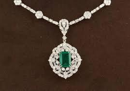 green emerald diamond white gold