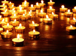 lit candle. large group of lit candles candle