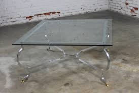 vintage hollywood regency square glass top cocktail table w aluminum base brass hoof feet