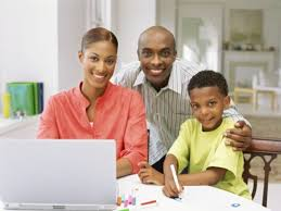 Parents helping children doing homework     Stock Photo