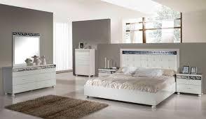 white modern master bedroom. Elegant White Tufted Headboard For Modern Master Bedroom Ideas With Stunning Silver Framed Mirror