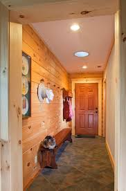 log home entry mudroom with tile floor