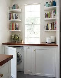 hidden laundry spaces - washer and dryer behind lower cabinet doors from  Home Trend Design via
