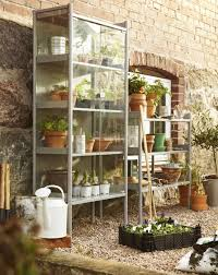 above made of powder coated galvanized steel with glass doors a gray hindí greenhouse cabinet measures 56 3 4 inches high and 24 3 4 inches wide