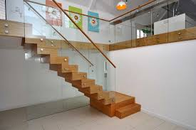 Winsome Hardwood Brown Veneer Floating Stairs with Glass Balustrade System  and White Wall Added Portray as