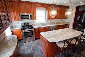 honey oak kitchen cabinets with black countertops white