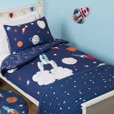 navy bedding with space rocket motif