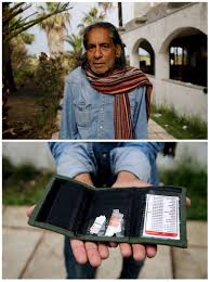 photo essay migrants share their most cherished belongings pbs i migrant mohamed ayub 51 holding the most valuable item he currently owns