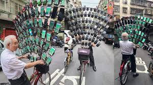 Taiwan's Pokémon GO Grandpa is back with 64 phones mounted on his bike