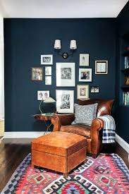 blue walls brown furniture. Family Living Room With Dark Blue Walls, Colorful Rug And Leather Armchair | NONAGON. Walls Brown Furniture B