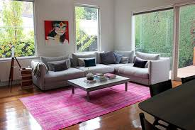 overdyed vintage kilim in vibrant pink looks stunning in a contemporary setting photo courtesy of cherry and me