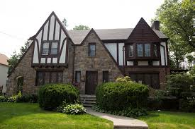 Most Tudor revival-style homes have multiple gables, half-timbering, leaded-