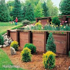 Brick Retaining Wall Design Example How To Build A Treated Wood Retaining Wall Family Handyman