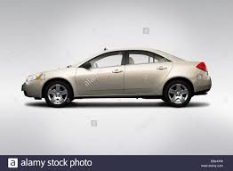 2009 Pontiac G6 in Gold - Drivers Side Profile Stock Photo ...