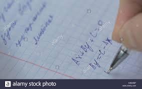 mathematics equations close up homework solving mathematical problem student solves the equation on paper