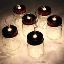 Lighting in a jar Outdoor Rustic Mini Mason Jars Are Lit By Warm White For And Comforting Fairy Lighting Read More Marquezrobledoco Rustic Mini Mason Jars Are Lit By Warm White For And Comforting