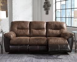 Follett Brown Reclining Sofa by Ashley Furniture