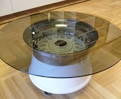 Picture of a fish aquarium coffee table . This is made of acrylic and  octagonal in shape. The base of the coffee table comes with a lighted, ...