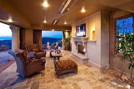 argent heating and cooling with mediterranean patio and brick trim carved stone columns covered patio curtain panels fireplace iron scrollwork mantels