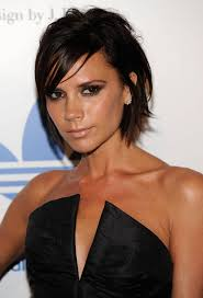 Love her or hate her, you gotta admit, Victoria Beckham has great hair. She often shows how versatile the angular bob can be, wearing it brushed forward (as ... - 91296236