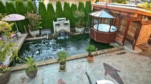 Wonderful Backyard With Deck Hot Tub Idea Feat Huge Waterfall And Flagstone  Floor Plus Modern Rectangular