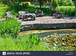 unusual garden furniture. an unusual set of wooden garden furniture made out driftwood on a terrace by