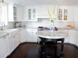 white bathrooms with dark floors white and black kitchen cabinets