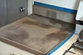 most of all i love the industrial look the diy concrete countertops add to the kitchen and especially the variation and imperfections in the surface of