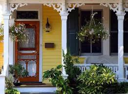 This is a darling little victorian porch with ornate scroll woodwork at the top