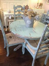 Distressed pale blue shabby table and chairs with French script fabric