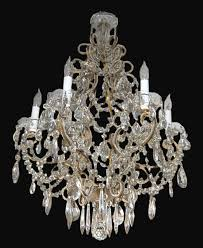 early 20th century french crystal beaded chandelier having six electrified lights on a scrolled bronze frame adorned with crystal swags and terminating on