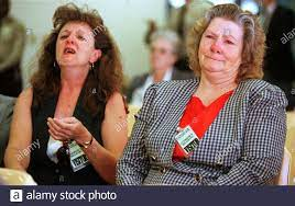 Janie Hickman (R), the girlfriend of Walter LaGrand and his sister Patricia  (L), weep as they