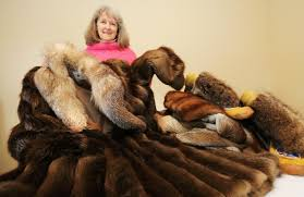 gail pettinger shows some of the donated fur coats that will eventually make their way to the arctic