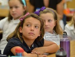 BEACH, CALIF. USA -- Third grader Ava Bishop listens as Lowell... News  Photo - Getty Images
