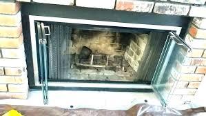fireplace folding glass doors fireplace bi fold glass doors fish how to remove glass fireplace folding glass doors