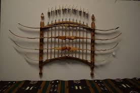 arch rack holds 4 bows and 12 arrows and can be easily disassembled for plastic toggles hold arrow shaft in place comes with wall mount hangers