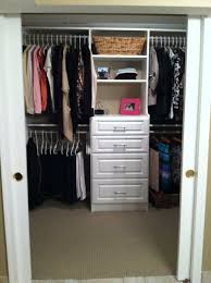 closet organizer system in white with 4 drawers and 4 hanger bars