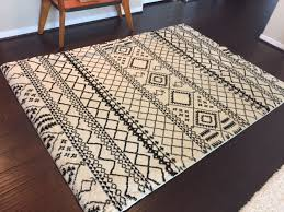 black and cream living room rug