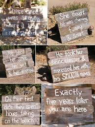 lago guiseppe winery wedding reclaimed barn wooden signs leading into the ceremony 1 of