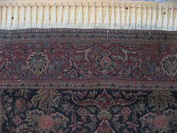 a fine kashan rug being given new fringes