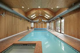 indoor swimming pool lighting. pool and hot tub housed in large wooden structure with wood paneling walls cathedral ceiling indoor swimming lighting