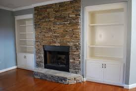 first grey wall paint plus wooden and shelfs as stone fireplace surround in fireplace tile ideas