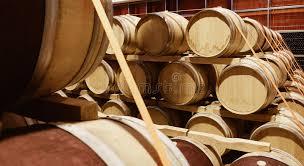 stacked oak barrels. Download Stacked Oak Wine Barrels In Modern Winery Stock Photo - Image Of Background, Vintage O
