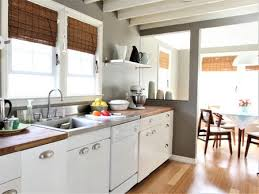 White country kitchen cabinets Farmhouse The Spruce White Kitchen Ideas From Contemporary To Country